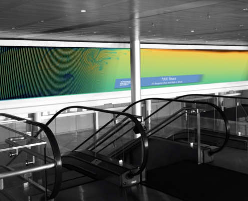 A long screen showing colorful ocean circulation currents, mostly blues, greens and yellows, at the Boston Convention and Exhibition Center