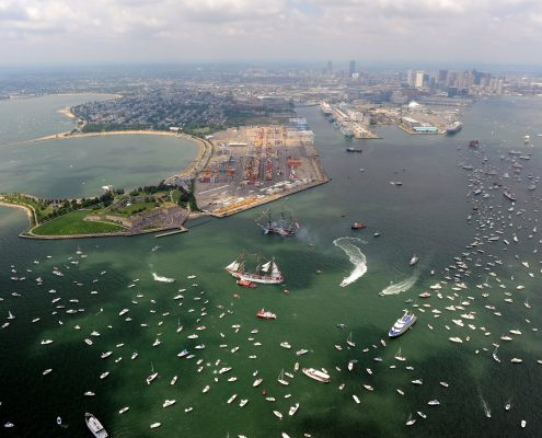 Aerial photograph of Castle Island and Massachusetts Bay with many boats and tall ships