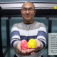 Dixia Fan, PhD, holding two 3D printed penguins, the Guardians of the Intelligent Towing Tank, which he is standing in front of