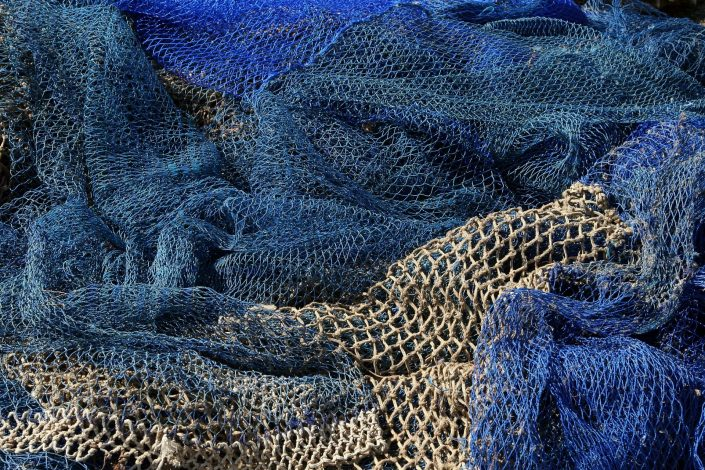 Close-up blue and beige fishing nets