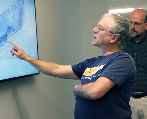 Michael Sacarny pointing to the Charles River map